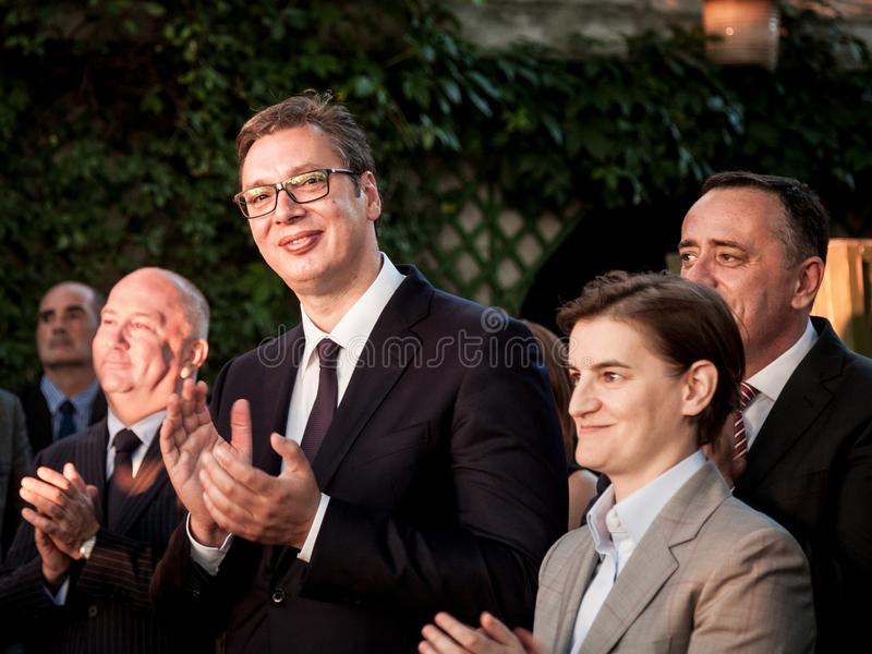 Aleksandar Vucic, President of Serbia, and Ana Brnabic, Serbian Prime Minister, applauding during a speech at the French embassy. Picture of Aleksandar Vucic and stock images