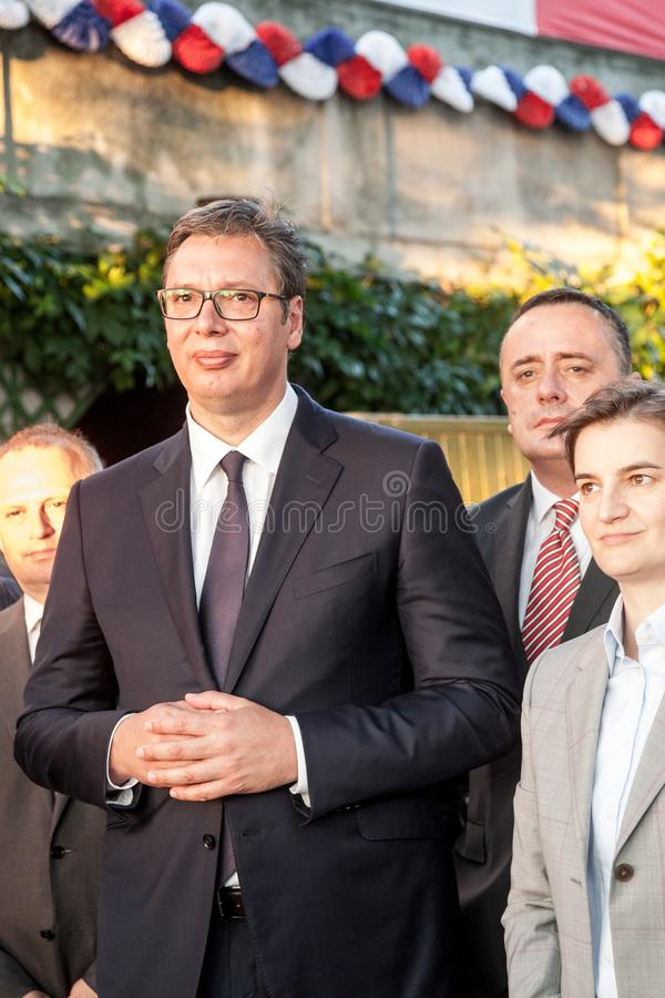 Aleksandar Vucic, President of Serbia standing and listening speech at French embassy while prime minister Ana Brnabic is visible. Picture of Aleksandar Vucic royalty free stock photography