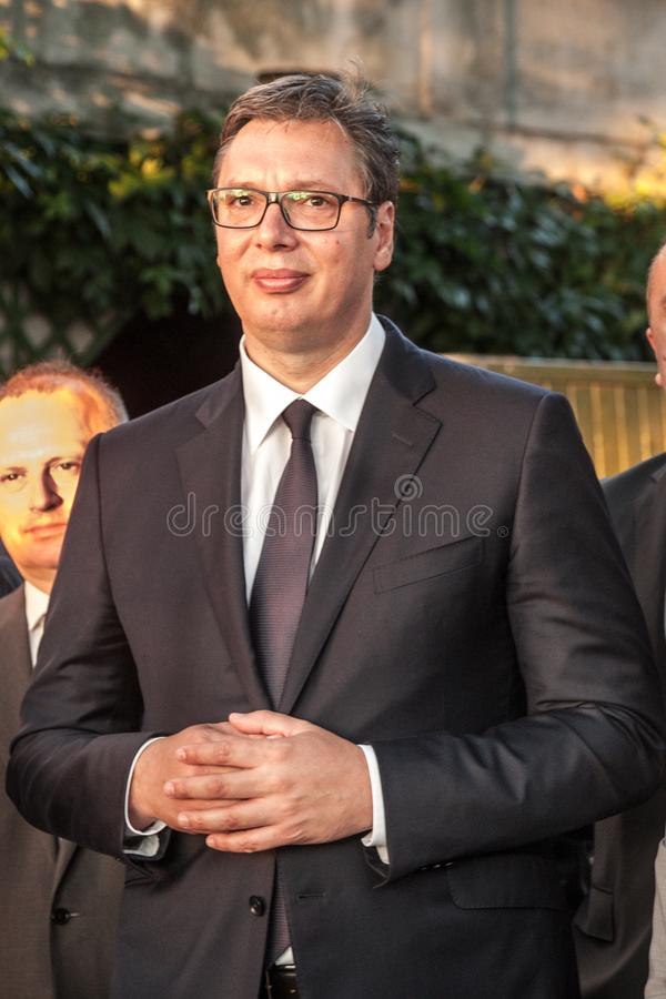 Aleksandar Vucic, President of Serbia standing and listening speech at the French embassy during a press conference. Picture of Aleksandar Vucic, president of stock image