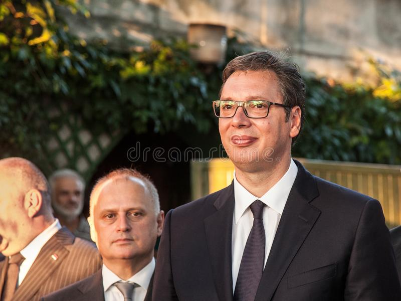 Aleksandar Vucic, President of Serbia standing and listening speech at the French embassy during a press conference. Picture of Aleksandar Vucic, president of royalty free stock images