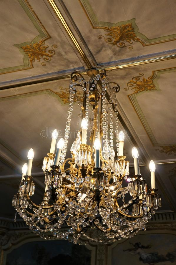 An ancient classic Chandelier and a ceiling royalty free stock photos