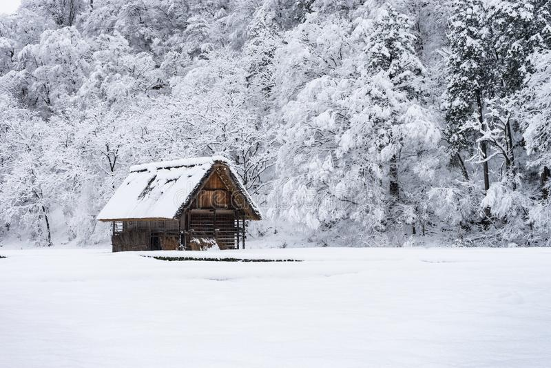picture of ancient houses and snow is heavy at Shirakawa-go village at Gifu, Japan. stock photos