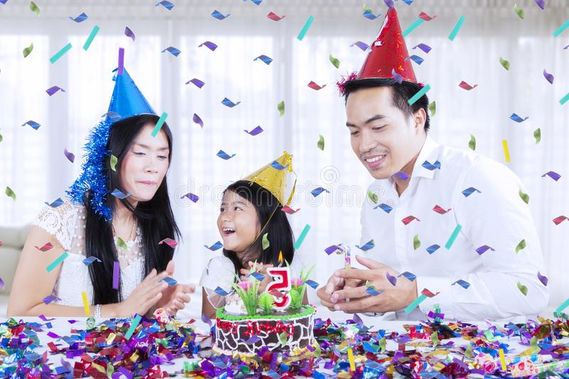 Asian family celebrating a birthday at home stock photography