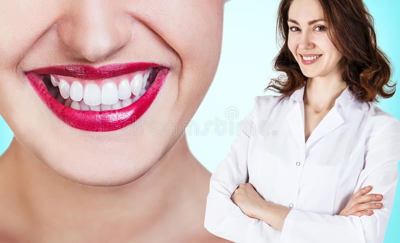 Picture of attractive female dentist with tools stock photo