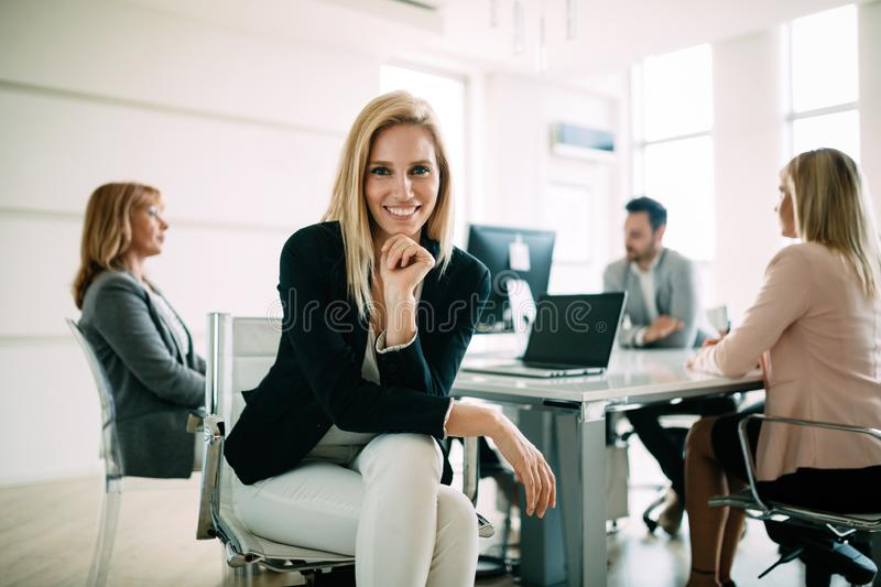 Picture of attractive sales workers on meeting in office stock image