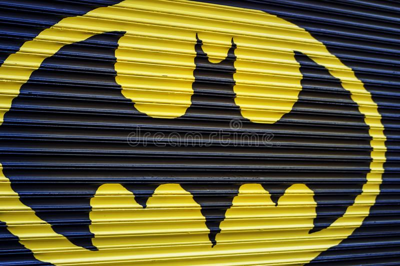 Batman symbol on a garage door. A picture of a Batman symbol on a garage door in the summer royalty free stock photo