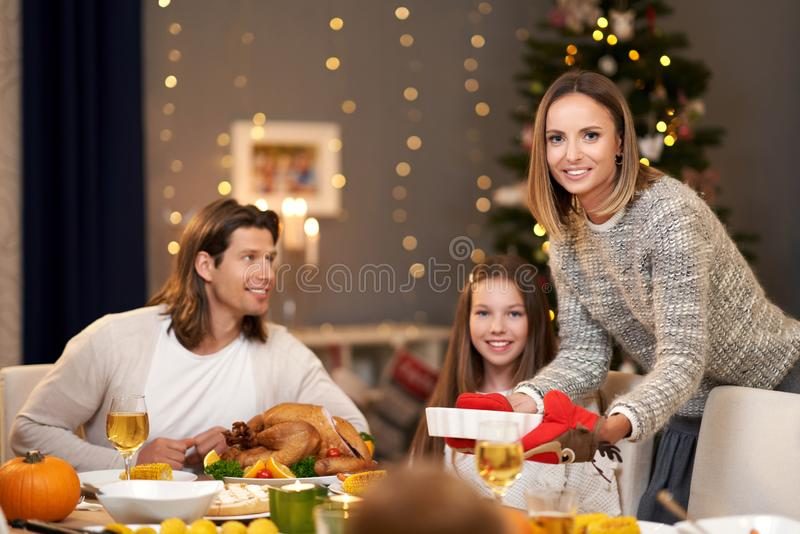 Beautiful family eating Christmas dinner at home stock image