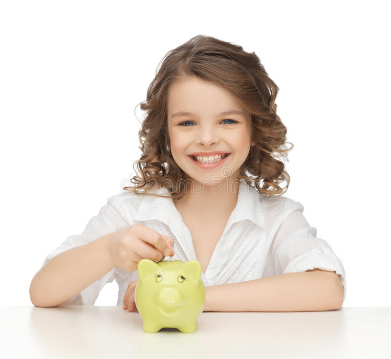 Girl With Piggy Bank Stock Images