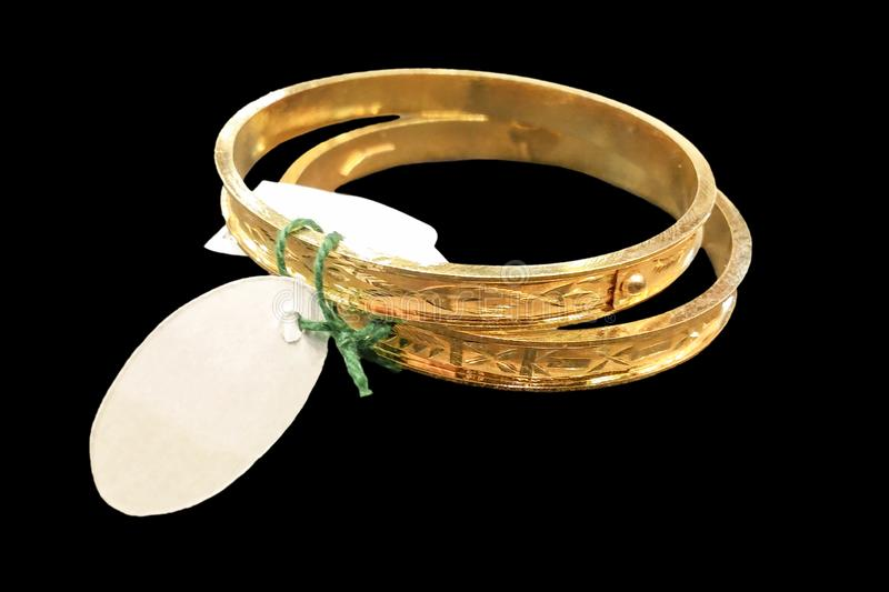 Picture of a beautiful gold bangle on a black isolated backgroun royalty free stock images
