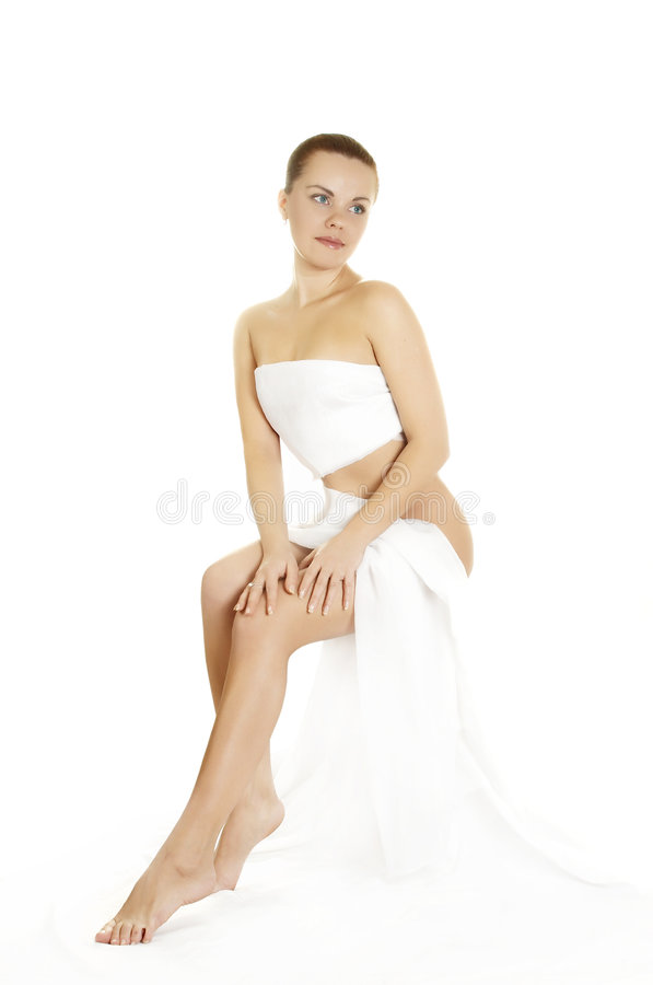 Picture of beautiful lady. The girl in a white fabric after cosmetic procedures royalty free stock images