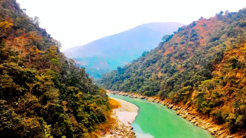 River flows bitween two mountain, Siliguri tourism, Indian city tour. This is a picture of beautiful landscape view of Siliguri tourism, Indian city tour. In stock photography