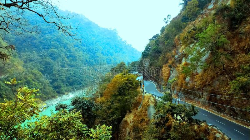 Road besides mountain and river, mountain road way, Siliguri tourism, Indian city tour. This is a picture of a beautiful landscape view of Siliguri tourism royalty free stock photos