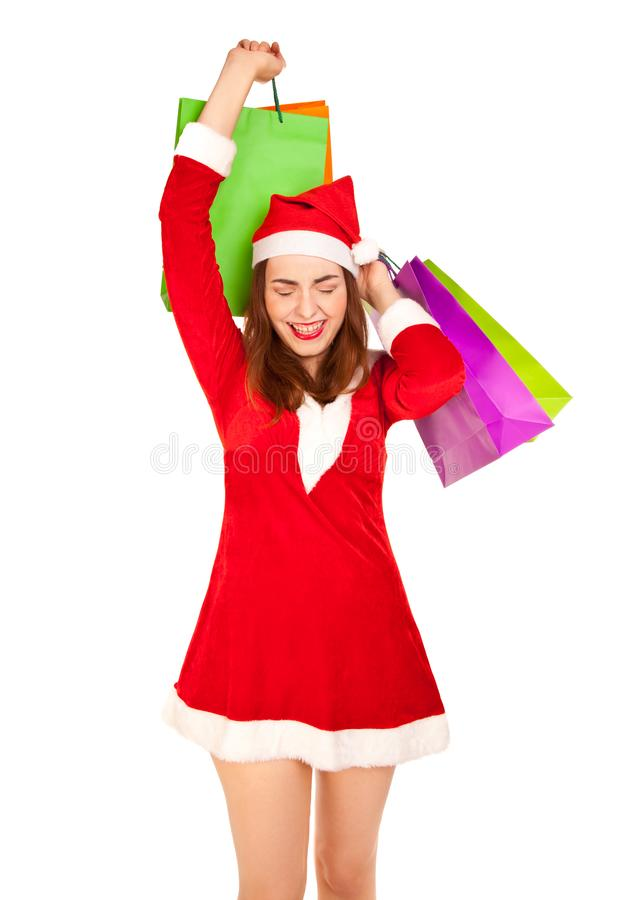 Beautiful woman in new year costume with shopping bags royalty free stock photography