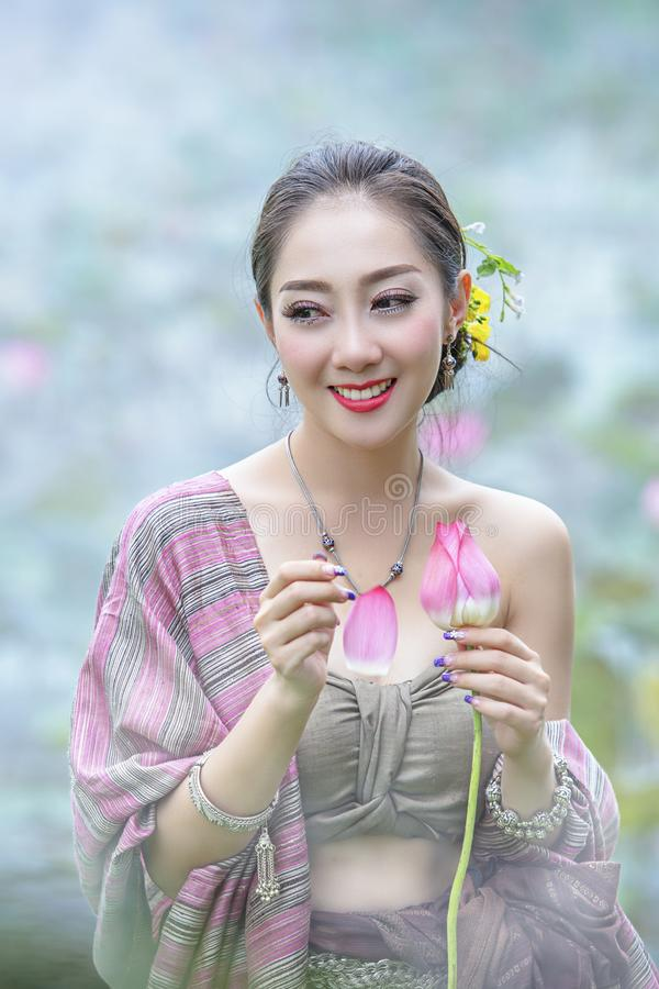 Woman with lotus flower royalty free stock photo