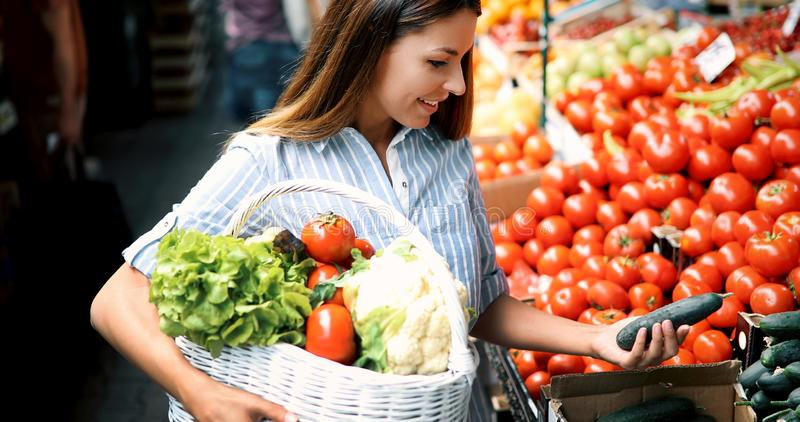 Picture of woman at marketplace buying fruits royalty free stock photos