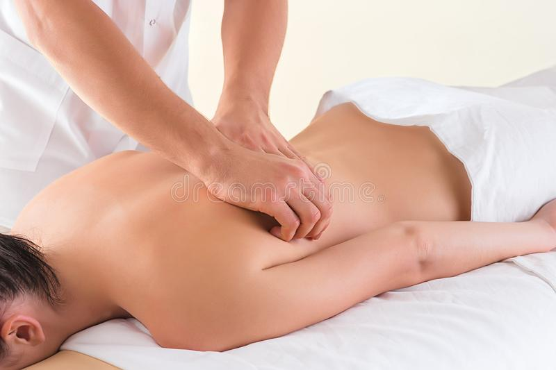 The picture of beautiful woman in massage salon. And male hands close up royalty free stock photos