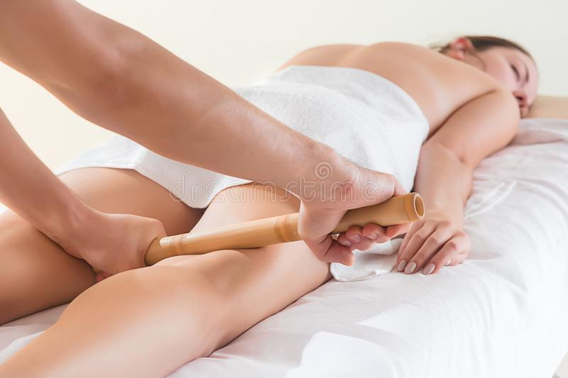 The picture of beautiful woman in massage salon. And male hands close up stock photography