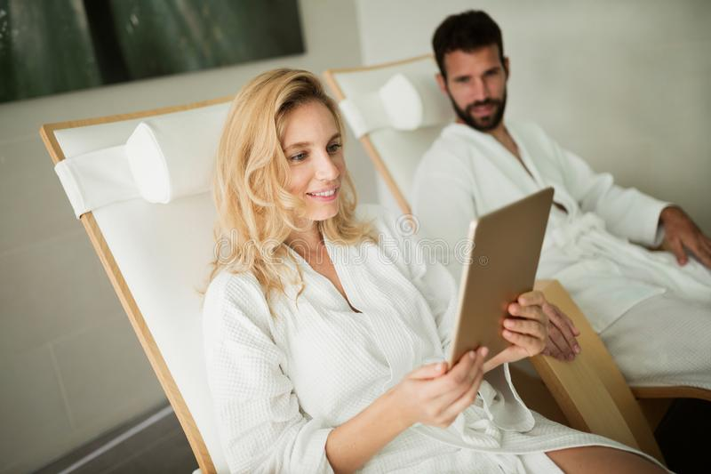 Picture of beautiful woman relaxing in spa center. Picture of beautiful women relaxing and using tablet in spa center stock photo