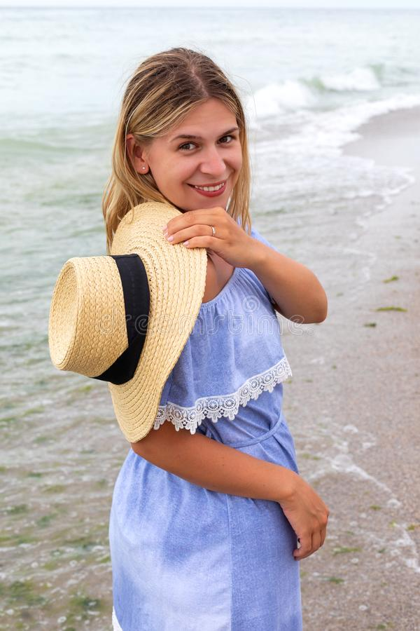 Woman in blue sundress stock images