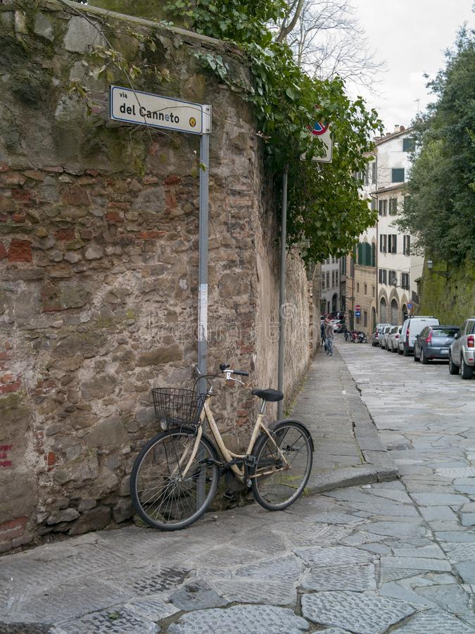 Bike leaning to the wall in Florence royalty free stock photography