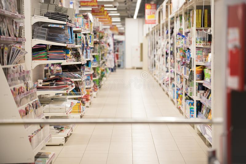 Picture blurred for background abstract. Blurred shelves in the supermarket with books and magazines. royalty free stock photo