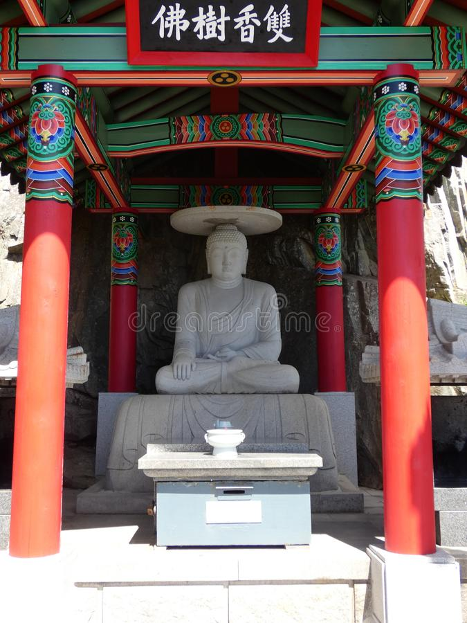 Bouddha en pierre. Picture of bouddha in stone at the temple `Haedong Yonggungsa` located near the sea at Busan in south Korea royalty free stock photography