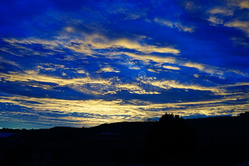 A bright blue sunset in New Mexico royalty free stock images