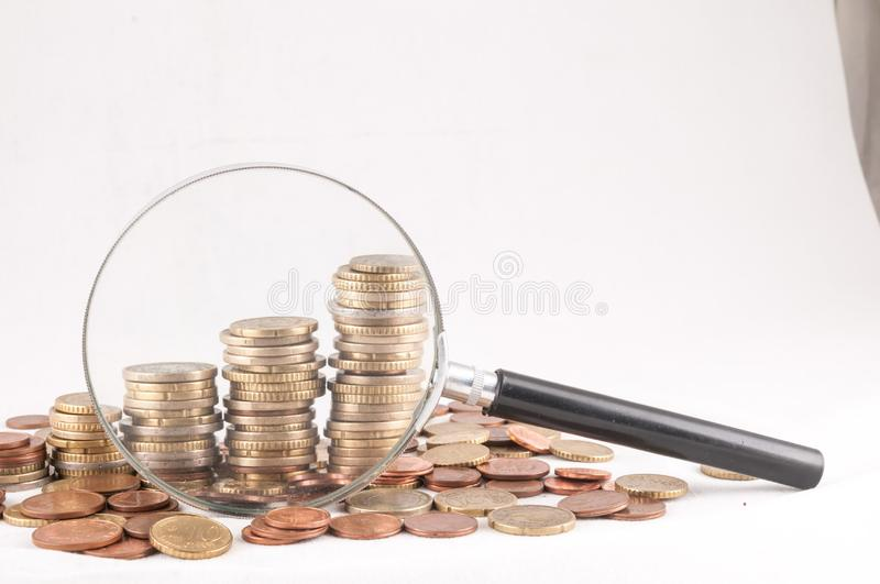 Business Money Concept Idea. Picture of a Business Money Concept Idea Coins and Loupe Magnify Glass royalty free stock images