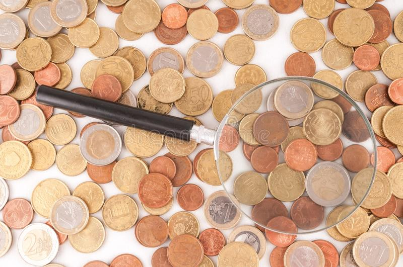 Business Money Concept Idea. Picture of a Business Money Concept Idea Coins and Loupe Magnify Glass royalty free stock image