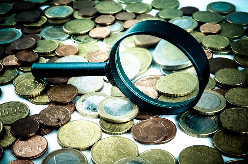 Business Money Concept Idea. Picture of a Business Money Concept Idea Conis and Magnify Glass royalty free stock photos