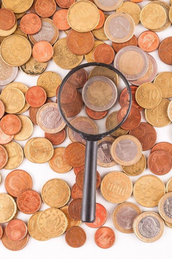 Business Money Concept Idea. Picture of a Business Money Concept Idea Conis and Magnify Glass stock photos