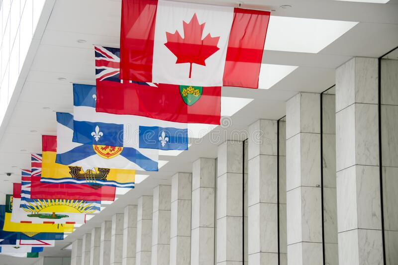 Canadian Flag along with the flags of the 10 Canadian Provinces and the 3 Canadian Territories in Toronto, Canada. Picture of the canadian Flag along with the stock photo
