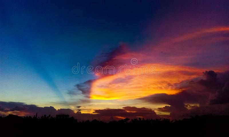Sky Sunsets Colour Clouds Rainbow. This picture is captured from Bosila, Dhaka. It contains natures with beauty of Sunsets. Townsman always missing open sky royalty free stock images