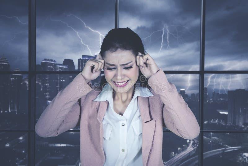 Caucasian businesswoman having headache stock image