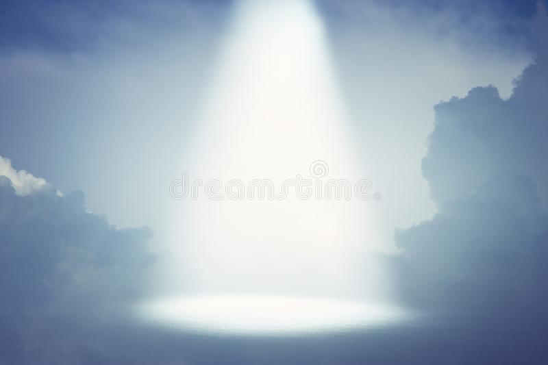 A picture of a celestial ray of light in the sky. Concept of religion and faith stock photos