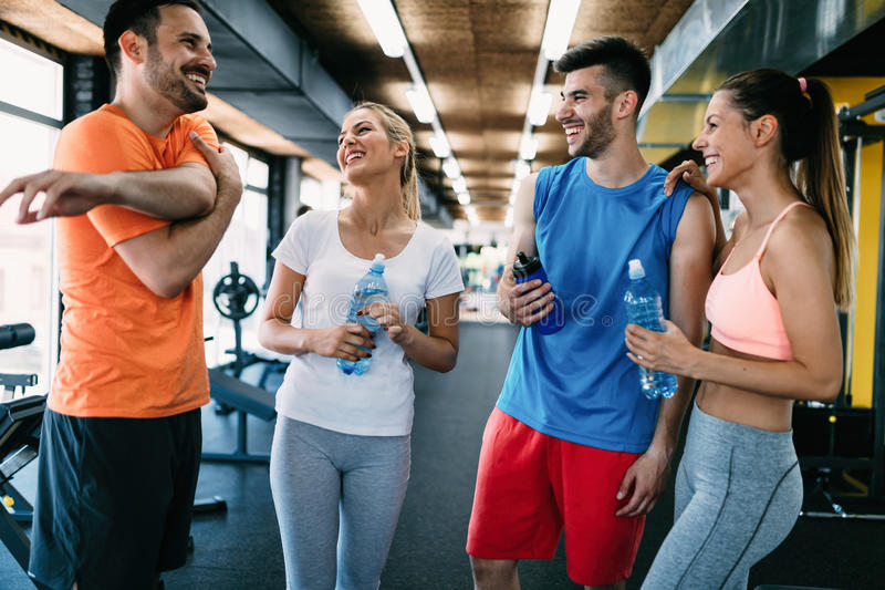 Picture of cheerful fitness team in gym royalty free stock images