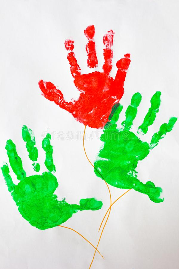 Picture of colorful print kids hands on white. Background royalty free illustration