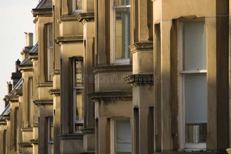 Victorian colony homes made of sandstone in Edinburgh, Scotland. Picture at Comely Bank Ave. Comely Bank is an area of Edinburgh, the capital of Scotland. It stock photography