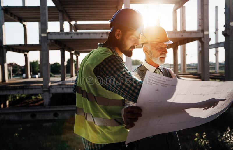 Picture of construction engineer working on building site stock photo