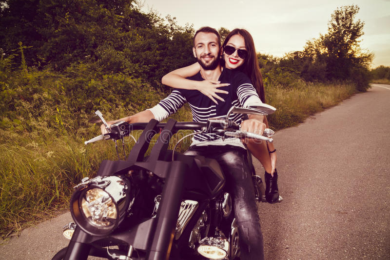 Picture with a couple of beautiful young bikers stock image