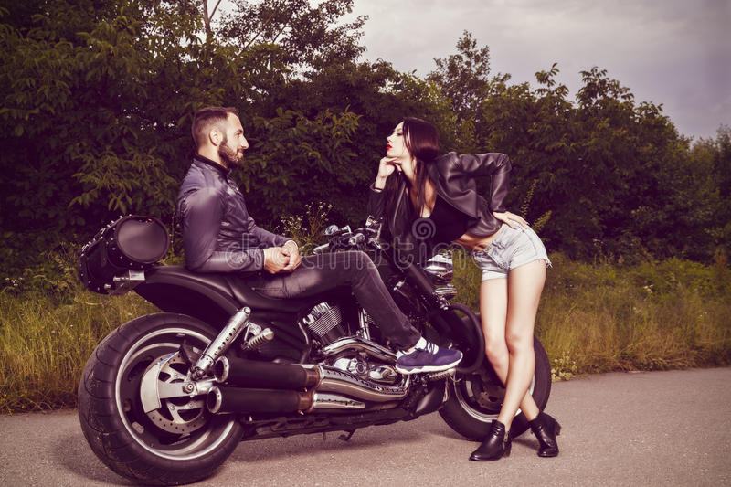 Picture with a couple of beautiful young bikers stock photos
