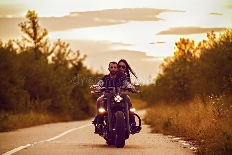 Picture with a couple of beautiful young bikers royalty free stock photo