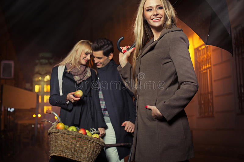 Picture of couple posing with female friend royalty free stock photography