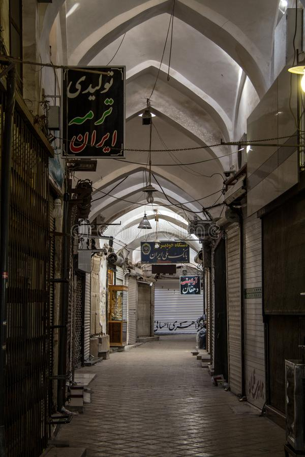 Street of the Yazd Khan bazar in the afternoon, empty and deserted, in a covered alley of the market. royalty free stock images