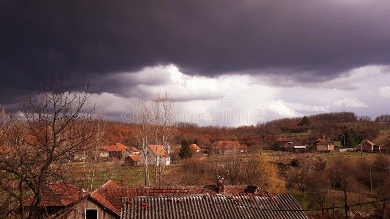 Dark sky over village. Picture of Dark sky over village royalty free stock photo