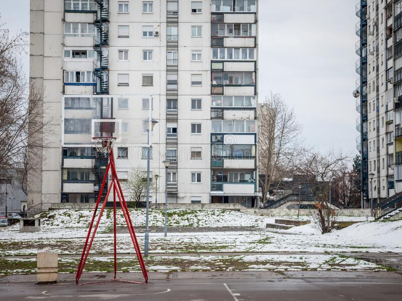 Decaying Basketball playground in front of communist buildings in the district of Novi Beograd, or New Belgrade, in Serbia. Picture of a derelict basketball royalty free stock photos