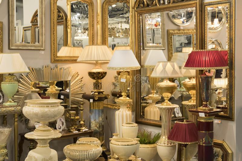 Picture of different modern beautiful stylish lamps and mirrors in the furniture store royalty free stock images