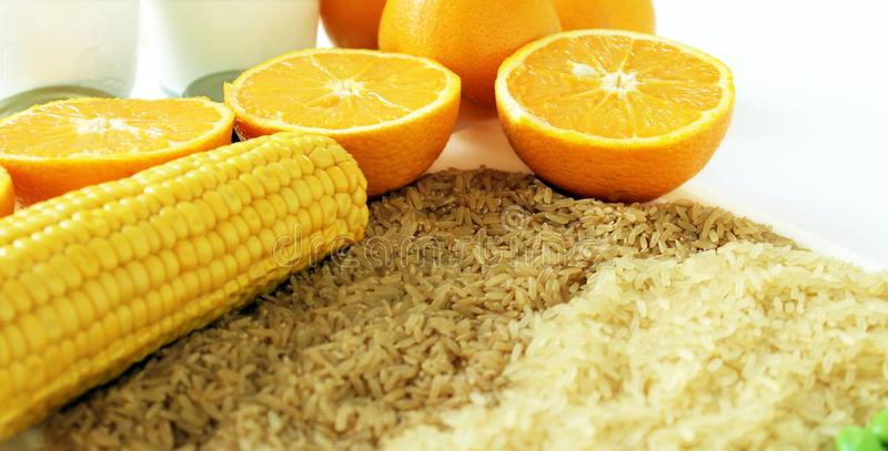Commodity close up with milk, metal, oranges, corn, rice and soybeans. Picture of different raw materials that are needed in everyday life and that are traded on stock image