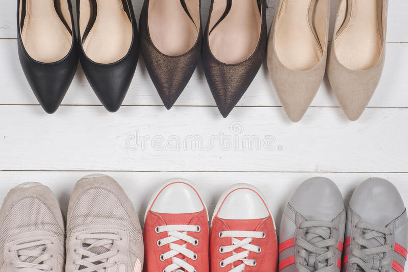 A picture of different shoes, Shot of several types of shoes, Several designs of women shoes. Leather Shoe, Sport Shoe. Pile of v royalty free stock photography