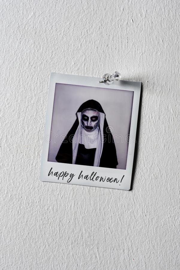 Picture of an evil nun and text happy halloween. A picture of a frightening evil nun, wearing a typical black and white habit, with the text happy Halloween royalty free stock photos